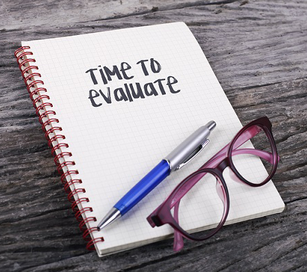 "image of notepad that says ""Time to Evaluate"""
