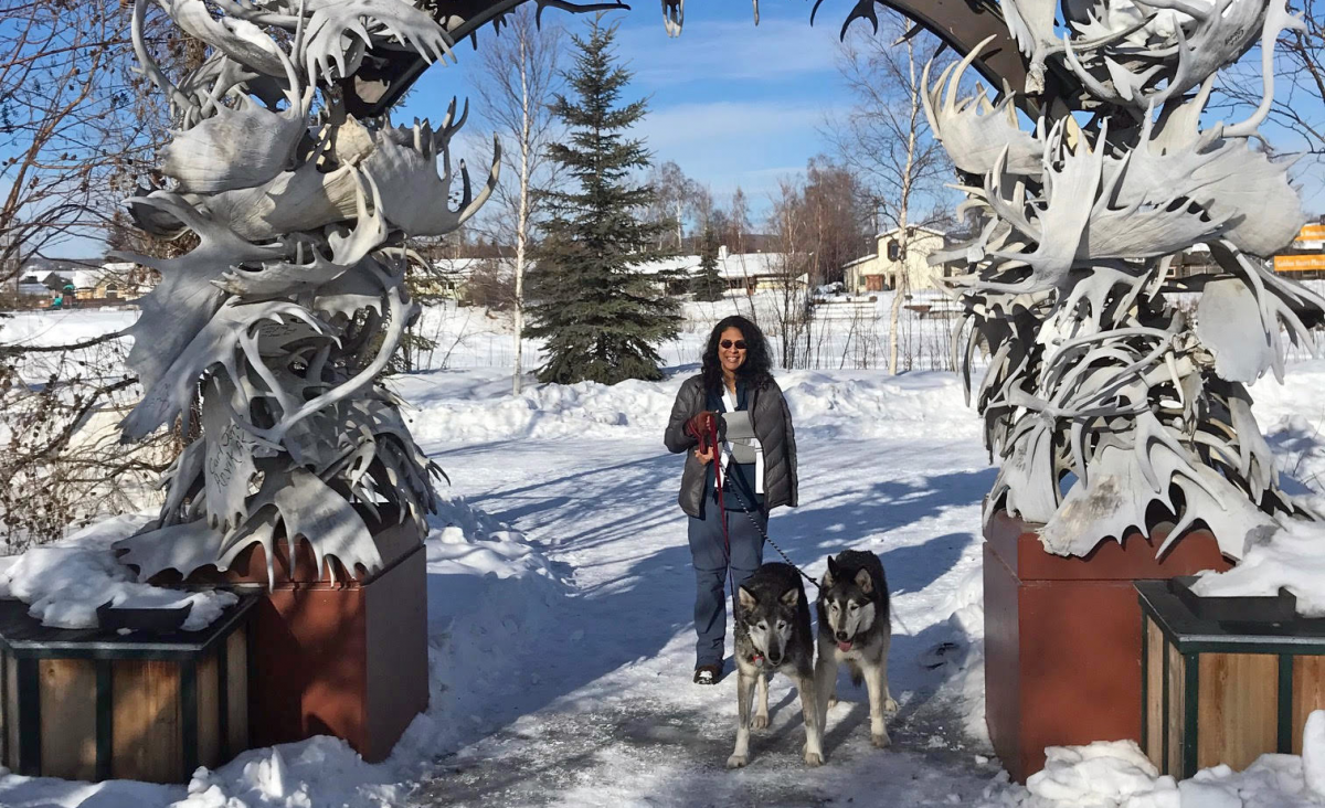 Denise Lawson with two huskies