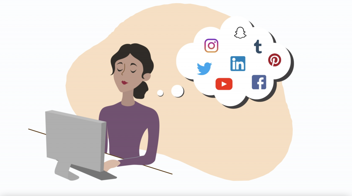woman sitting at laptop thinking of the various social media accounts she uses